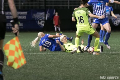 Reign FC's Megan Rapinoe #15 looks towards the ref after a collision with Breakers' midfielder Adriana Leon #19.