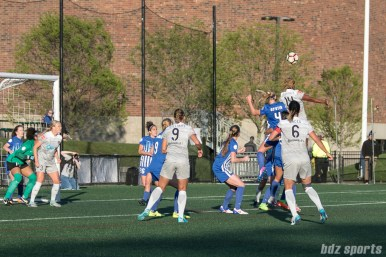 Breakers' Megan Oyster #4 challenges Courage's Jess McDonald #14 for the ball off a corner kick.