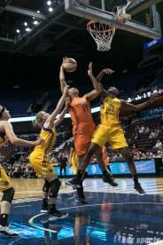 Sparks' Avery Warley-Talbert #33 challenges Sun's Brionna Jones #35 for the rebound.