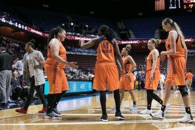 Sun's Shekinna Stricklen #40 high fives Danielle Adams #11 after a Sparks timeout.