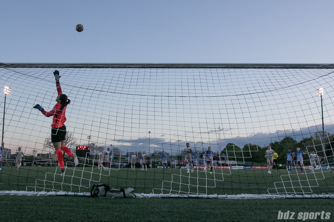 Courage goalkeeper Sabrina D'Angelo #1 watches a Breakers' shot go over the crossbar.