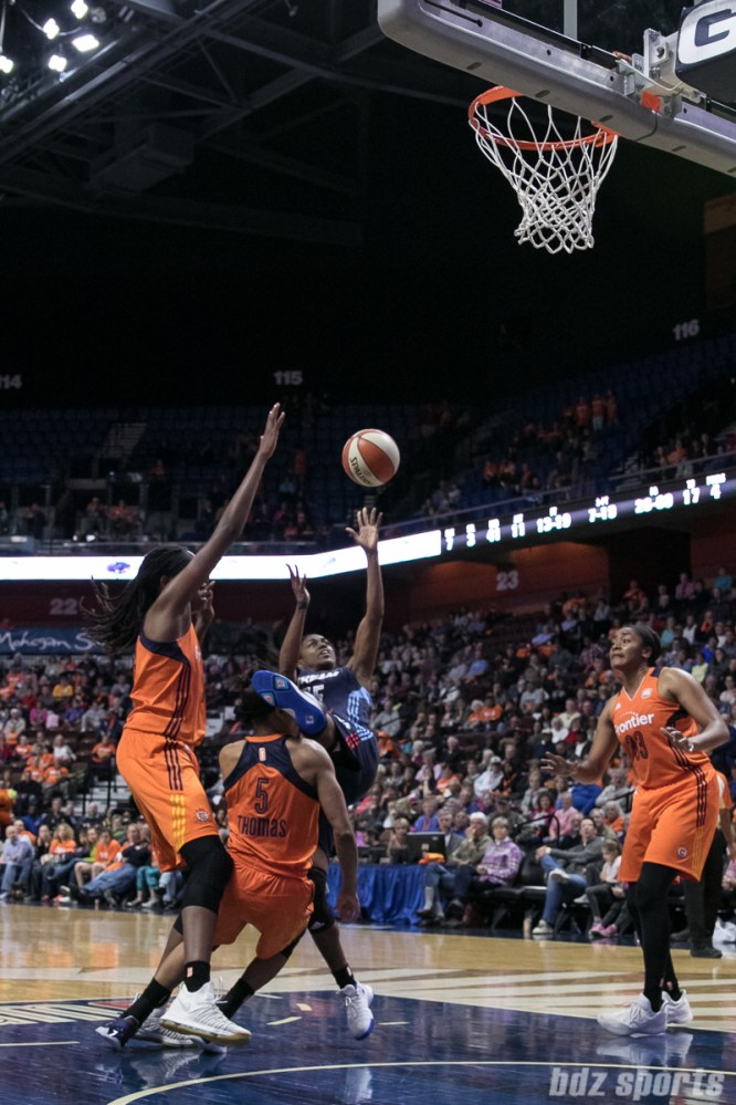 The foot of Atlanta Dream's Tiffany Hayes #15 catches the Sun's Jasmine Thomas #5 in the head.