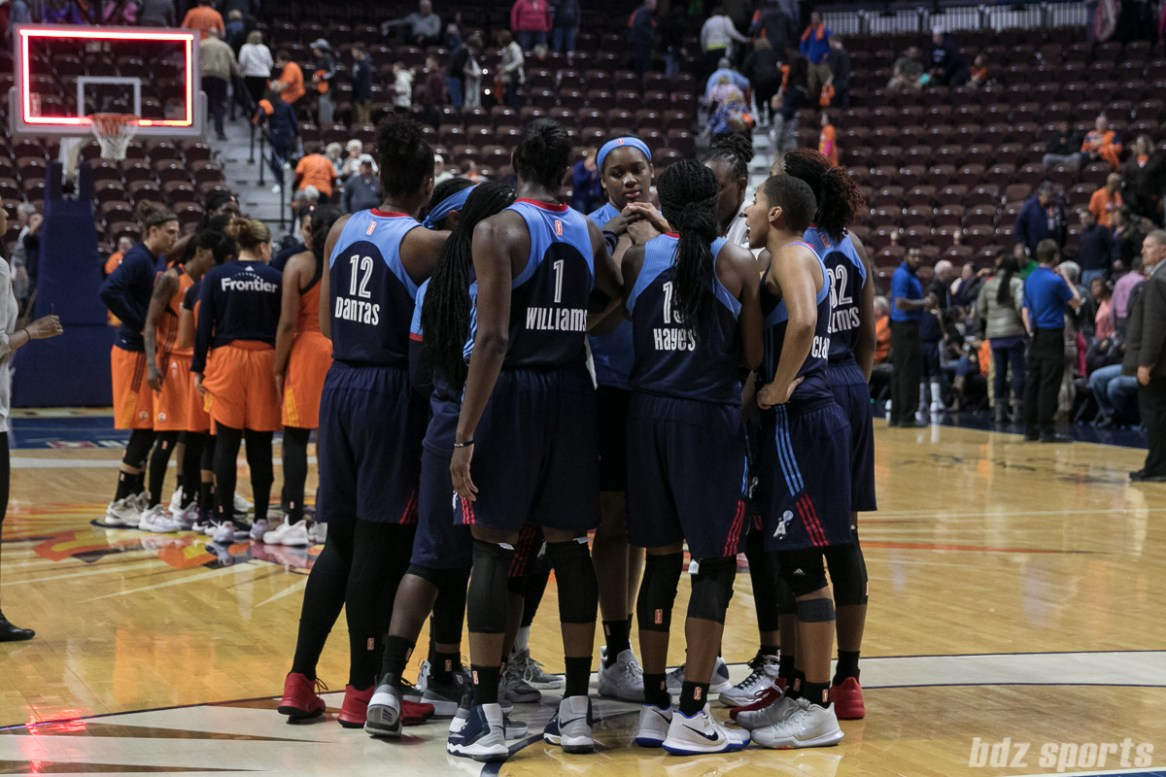 The Dream huddle after defeating the Sun 81 - 74.