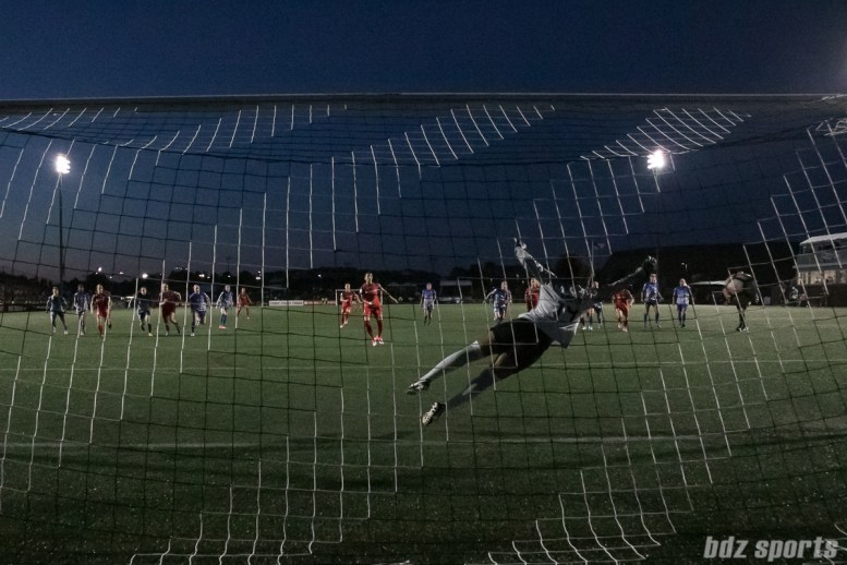 Boston Breakers goalkeeper Abby Smith (14) dives for a penalty kick ball shot by Portland Thorns FC forward Nadia Nadim (9).