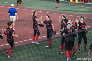 The Akron Racers high five after ending the inning.