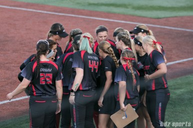 The Akron Racers huddle before the start of an inning.