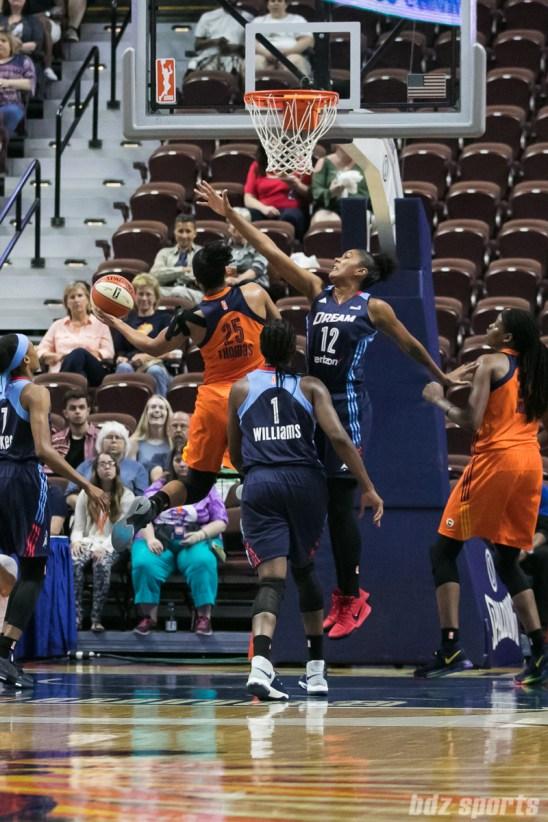 Connecticut Sun forward Alyssa Thomas (25) drives to the basket against Atlanta Dream forward Damiris Dantas (12).
