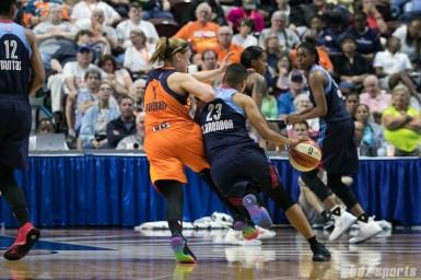 Atlanta Dream guard Layshia Clarendon (23) takes on Connecticut Sun guard Rachel Banham (1).