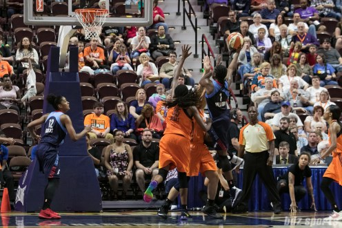 Atlanta Dream center Elizabeth Williams (1) looks to the lay-in the ball over two Connecticut Sun defenders.