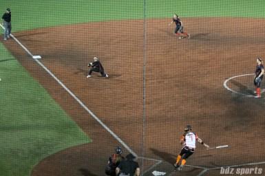 Akron Racers third baseman Kelley Montalvo (10) catches out Chicago Bandits infielder Danielle Zymkowitz (7).