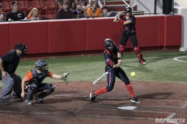 Akron Racers second baseman Alex Hugo (16) swings at an incoming pitch.