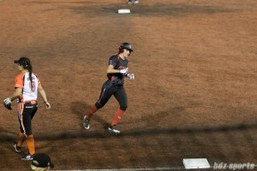Akron Racers second baseman Ashley Thomas (1) rounds the bases after teammate Jennifer Gilbert (not pictured) hit a homerun.
