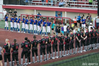 The Chicago Bandits and Akron Racers stand during pre-game ceremonies.