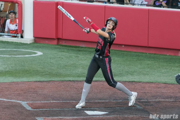 Akron Racers outfielder Jennifer Gilbert (25) looks on as the ball flies into foul territory.