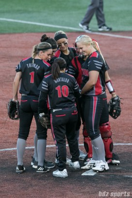 Akron Racers infielders huddle before the start of the inning.