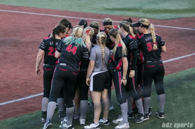 Akron Racers huddle before the start of the next inning.