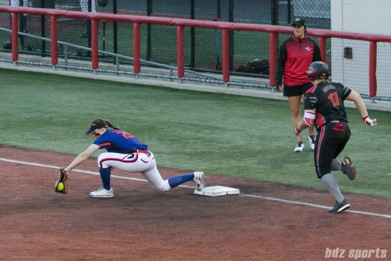 Chicago Bandits first baseman Megan Blank (21) catches out Akron Racers pitcher Sara Groenewegen (17) at first base.