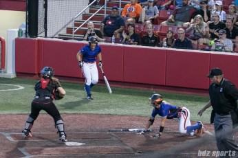 Chicago Bandits infielder Natalie Hernandez (16) reacts to teammate Brenna Moss (55) scoring.