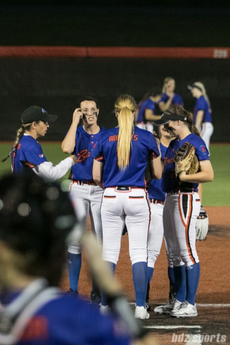 The Chicago Bandits huddle after the game resumes from the rain delay.