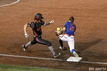 Chicago Bandits first baseman Megan Blank (21) is unable to hold on to the ball as Akron Racers outfielder Shellie Robinson (3) gets to first base.