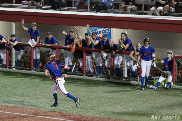 The Chicago Bandits dugout cheer on outfielder Danielle Zymkowitz (7) after being walked.