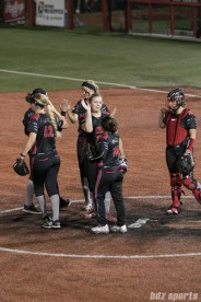 Akron Racers infielders high five before the start of the bottom of the 7th inning.