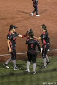 The Akron Racers high five before the start of the bottom of the 7th inning.