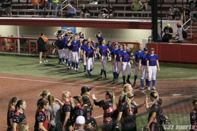 The Chicago Bandits look as the Akron Racers high five each other on their win.