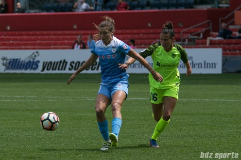 Chicago Red Stars forward Sofia Huerta (11) settles the ball while being defended by Seattle Reign FC defender Carson Pickett (16).
