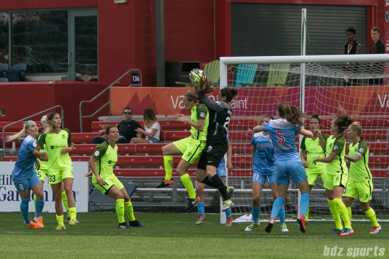Seattle Reign FC goalkeeper Haley Kopmeyer (28) grabs the ball off a corner kick.