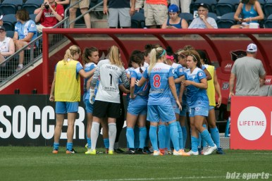 The Chicago Red Stars huddle before the start of the second half.