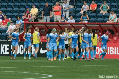 The Chicago Red Stars take the field to start the second half.