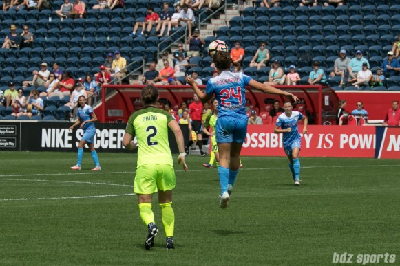 Chicago Red Stars midfielder Danielle Colaprico (24) heads the ball.