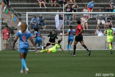 Chicago Red Stars forward Christen Press (23) gets a shot off past a sliding Seattle Reign FC defender Lauren Barnes (3) to score the game's lone goal.