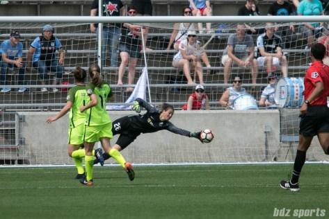 Seattle Reign FC goalkeeper Haley Kopmeyer (28) makes a save.