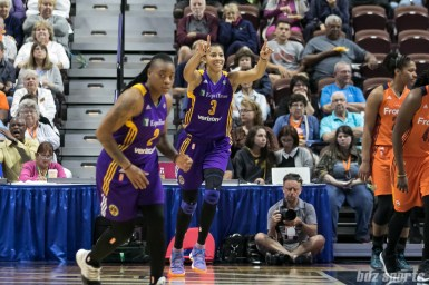 Los Angeles Sparks forward Candace Parker (3) looks towards teammate Nneka Ogwumike (not pictured) after Ogwumike's pass set her up for the basket.