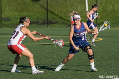 Long Island Sound attacker Christina Esposito (3) cradles the ball while being defended by Boston Storm defender Nicole Poli (21).