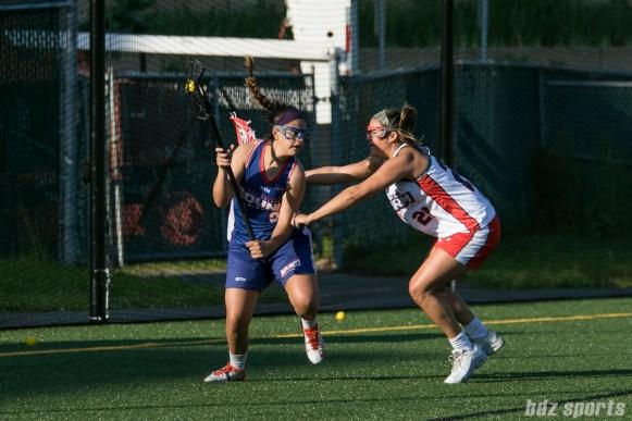 Boston Storm defender Nicole Poli (21) checks Long Island Sound attacker Halle Majorana (37).
