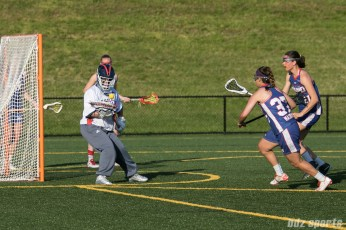 Boston Storm goalie Rachel Vallarelli (26) comes up with the ball.