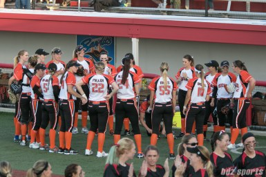 Chicago Bandits stand in a circle before the start of the game.