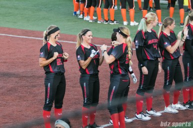 Akron Racers shortstop Ashley Thomas (1) and infielder Sam Fischer (52) do a handshake before the start of the game.