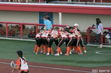 Players from the Chicago Bandits huddle before the start of the game.
