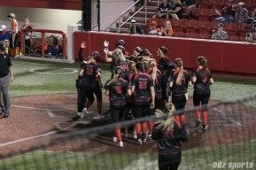 Akron Racers outfielder Jennifer Gilbert (25) is greeted by her teammates after hitting a two-run homerun in the top of the 7th inning.