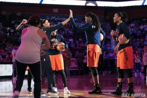 Connecticut Sun guard Jasmine Thomas (5) high fives teammate Jonquel Jones (35) during the starting lineup announcements.