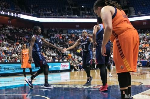 Atlanta Dream guard Brittney Sykes (7) high fives teammates in between shooting free throws.