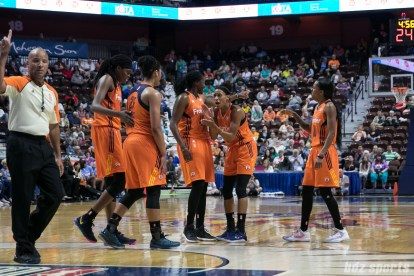 """The Connecticut Sun celebrate a basket """"and 1"""" call."""
