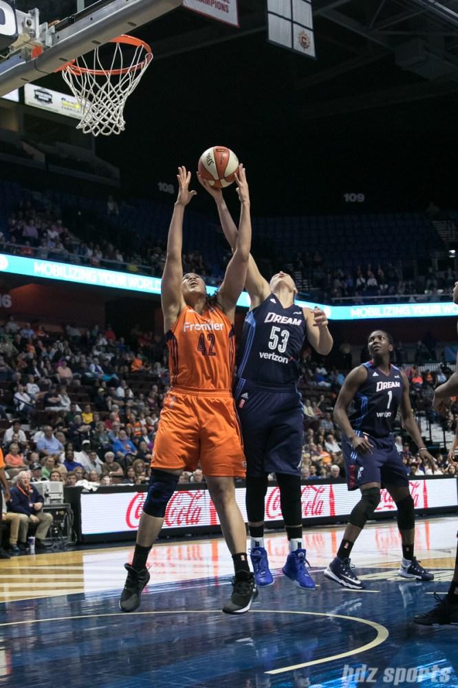 Connecticut Sun forward Brionna Jones (42) and Atlanta Dream forward Jordan Hooper (53) battle for the rebound.