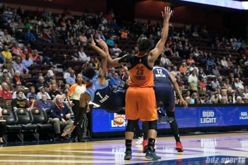 Atlanta Dream guard Brittney Sykes (7) goes airborne after colliding with Connecticut Sun forward Alyssa Thomas (25).
