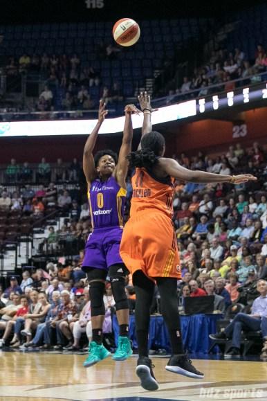 Los Angeles Sparks guard Alana Beard (0) takes a shot over the hand of Connecticut Sun forward Shekinna Stricklen (40).