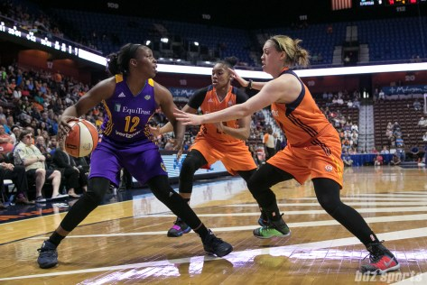 Los Angeles Sparks guard Chelsea Gray (12) gets double teamed by two Connecticut Sun defenders.